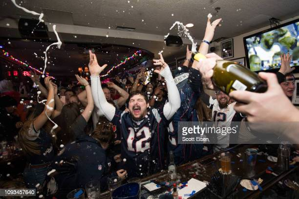 New England Patriots fans cheer after the New England Patriots beat the Los Angeles Rams in Super Bowl LIII at McGreevy's Bar on February 3 2019 in...