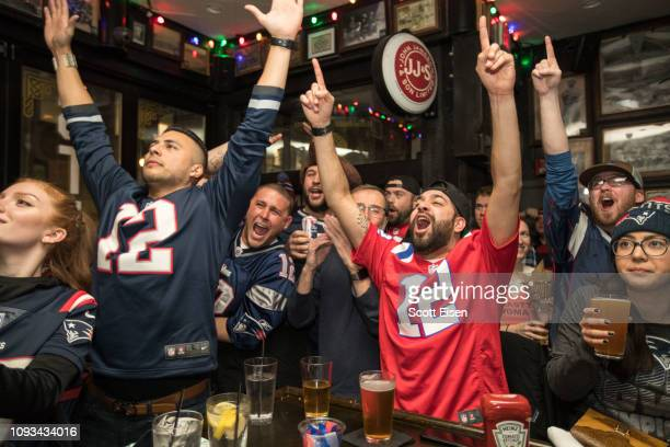 New England Patriots fans cheer during the first quarter of Super Bowl LIII at McGreevy's Bar on February 3, 2019 in Boston, Massachusetts. The New...