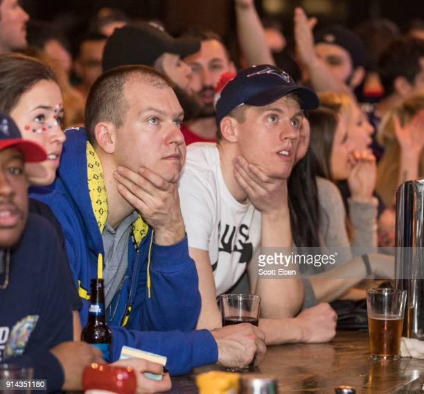 New England Patriots fans react as the Philadelphia Eagles pull ahead near the end of the of Superbowl LII on February 4 2018 in Boston Massachusetts...