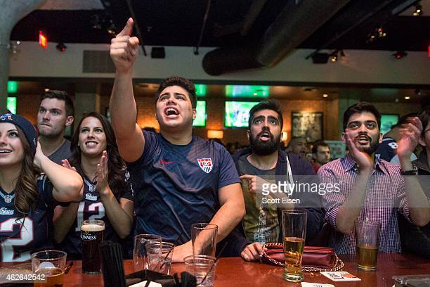 New England Patriots fans react during a Patriots touchdown run in the fourth quarter in Super Bowl XLIX at Jerry Remy's Sports Bar February 1 2015...