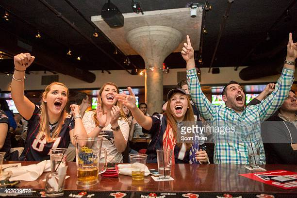 New England Patriots fans react to a Patriots' touchdown during the second quarter in Super Bowl XLIX at Jerry Remy's Sports Bar February 1 2015 in...