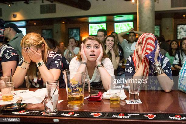 New England Patriots fans react to a Seattle Seahawks touchdown during the second quarter in Super Bowl XLIX at Jerry Remy's Sports Bar February 1...