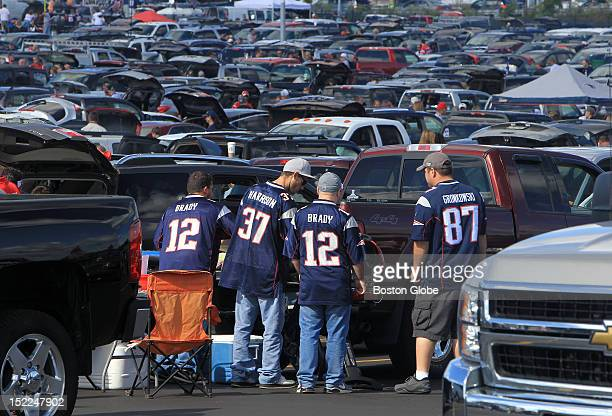 New England Patriots fans show their colors as they set up for tailgating in the parking lot at Patriot Place before the Patriots play the Arizona...
