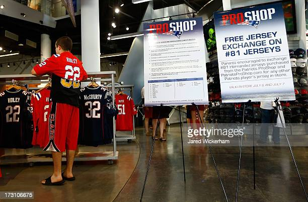 New England Patriots fans try on other jersey's after trading in their Aaron Hernandez jerseys during a free exchange at the pro shop at Gillette...