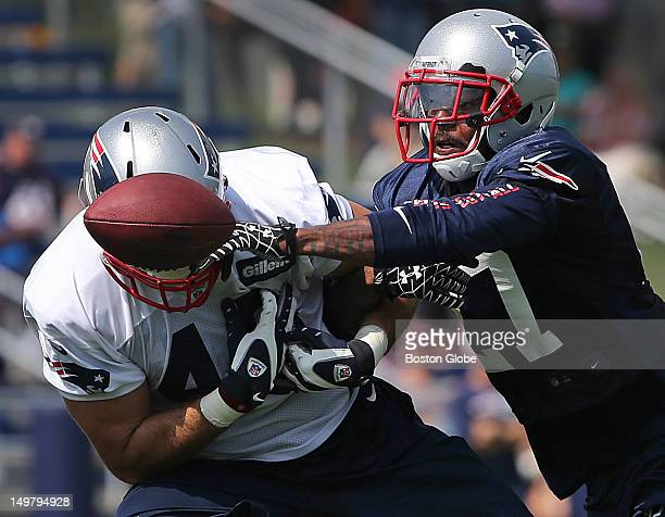 New England Patriots free safety Tavon Wilson defends a pass intended for New England Patriots tight end Alex Silvestro at practice during New...