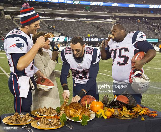 New England Patriots from left to right Tom Brady Steve Gregory and Vince Wilfork join television broadcaster Michele Tafoya in eating turkey legs...