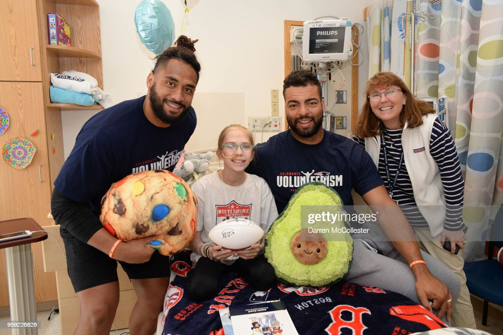 New England Patriots Harvey Langi (L) and Kyle Van Noy visit Caroline and Mom at Boston Children's Hospital on May 16, 2018 in Boston, Massachusetts.