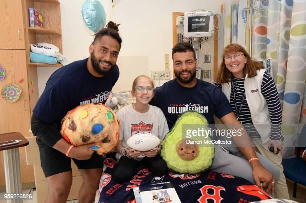 New England Patriots Harvey Langi and Kyle Van Noy visit Caroline and Mom at Boston Children's Hospital on May 16 2018 in Boston Massachusetts