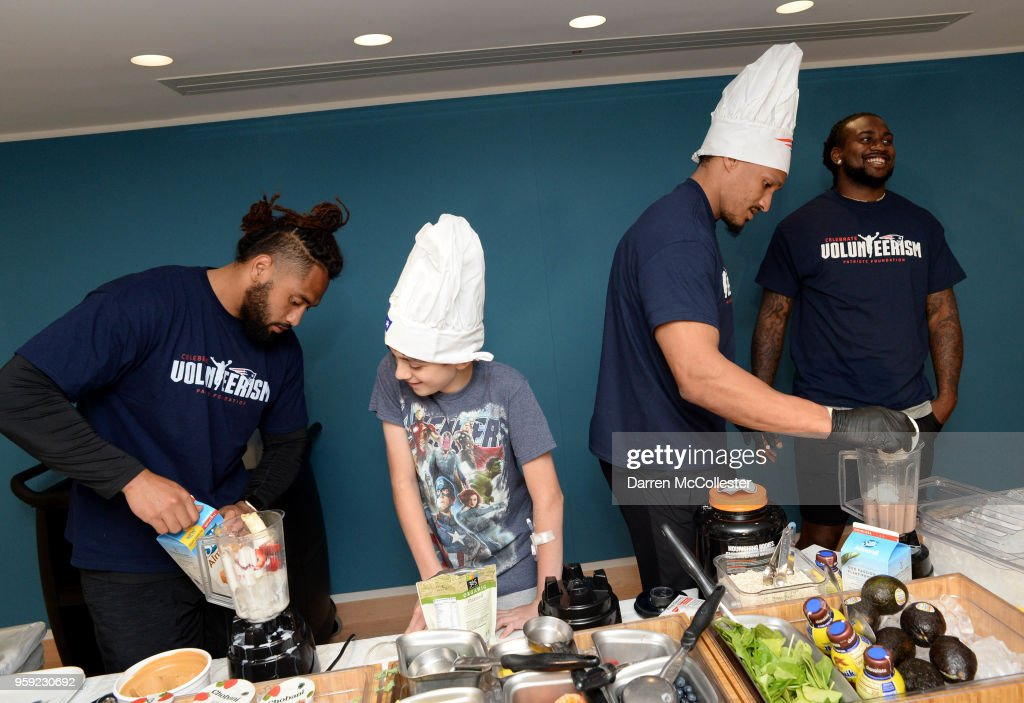 New England Patriots (L to R) Harvey Langi, Derek Rivers, and Cordarrelle Patterson make smoothies with Evan at Boston Children's Hospital on May 16, 2018 in Boston, Massachusetts.