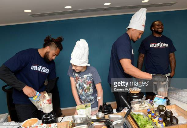 New England Patriots Harvey Langi Derek Rivers and Cordarrelle Patterson make smoothies with Evan at Boston Children's Hospital on May 16 2018 in...