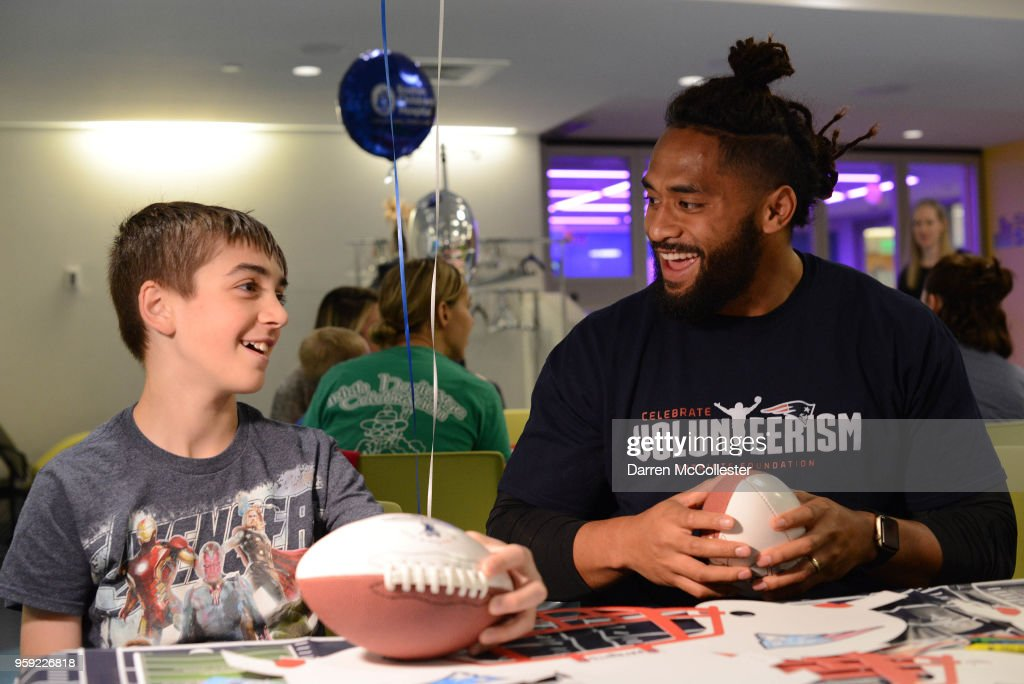 New England Patriots Harvey Langi visits with Evan at Boston Children's Hospital on May 16, 2018 in Boston, Massachusetts.