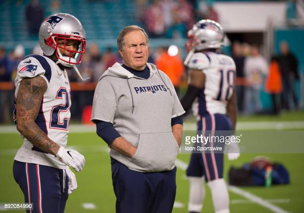 New England Patriots Head Coach Bill Belichick and New England Patriots Safety Patrick Chung tallk on the field before the start of the NFL football...