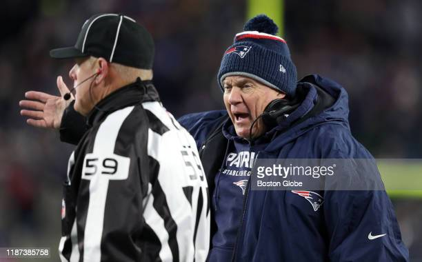 New England Patriots head coach Bill Belichick argues a point with line judge Rusty Baynes during the second half. The New England Patriots host the...
