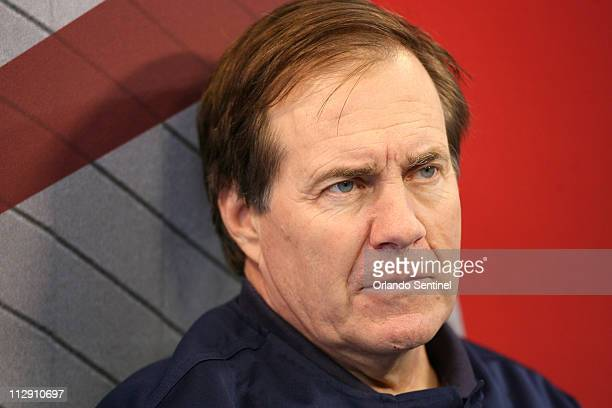 New England Patriots head coach Bill Belichick speaks to reporters during Super Bowl Media Day for Super Bowl XLII at the University of Phoenix...