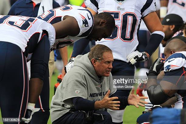 New England Patriots head coach Bill Belichick talks to his defense early in the game as the Patriots took on the Buffalo Bills at Ralph Wilson...