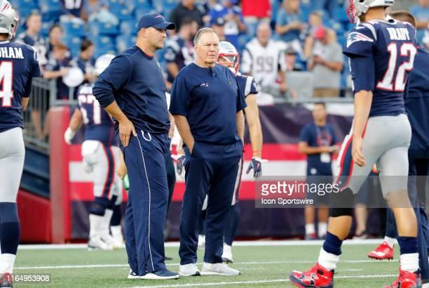 New England Patriots head coach Bill Belichick watches warm up with New England Patriots special teams coordinator / wide receivers coach Joe Judge...