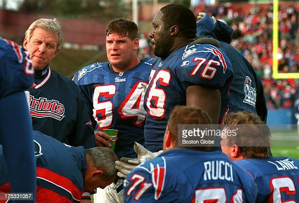 New England Patriots head coach Bill Parcells comes over for a chat with the offensive line including Dave Wohlabaugh William Roberts Max Lane and...