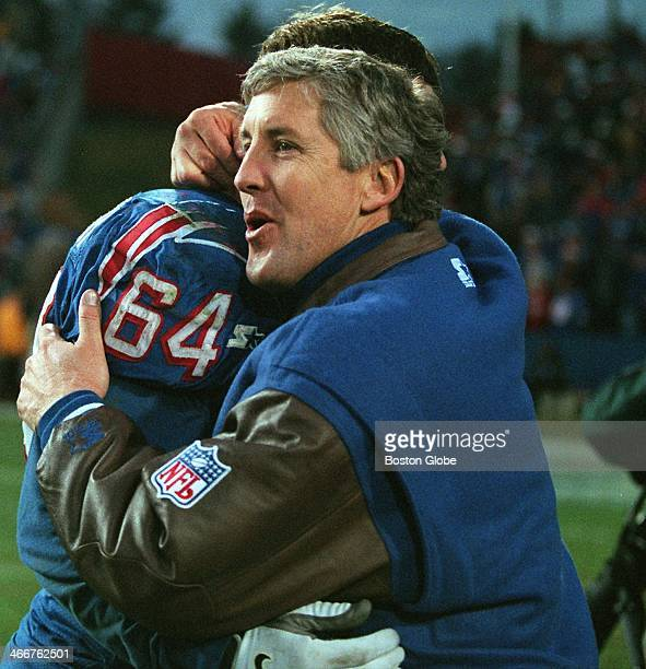 New England Patriots head coach Pete Carroll gives a hug to offensive lineman Dave Wohlabaugh following New England's 242 playoff clinching victory...