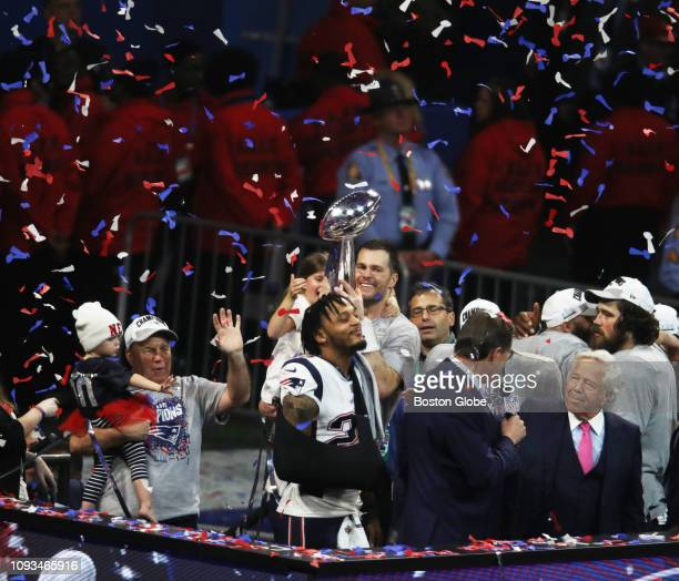 New England Patriots including Bill Belichick Tom Brady and Robert Kraft hold trophies and children on the podium The New England Patriots met the...