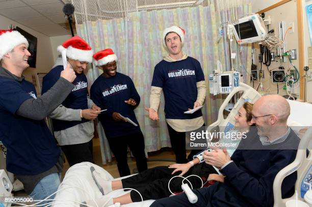 New England Patriot's Jacob Hollister Derek Rivers Phillip Dorsett and Cody Hollister visit Cameron and Dad at Boston Children's Hospital December 18...