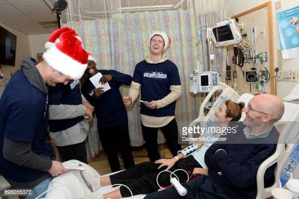 New England Patriot's Jacob Hollister Phillip Dorsett and Cody Hollister visit Cameron and Dad at Boston Children's Hospital December 18 2017 in...