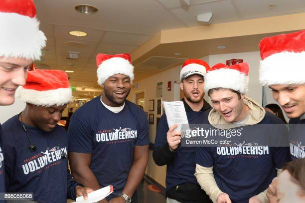 New England Patriot's Jacob Hollister Phillip Dorsett Dwayne Allen Trevor Reilly Cody Hollister and Derek Rivers sign holiday songs for the kids at...
