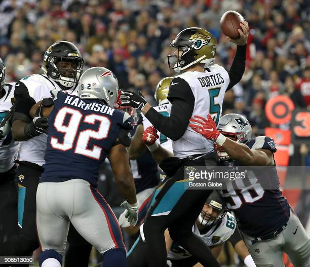 New England Patriots' James Harrison and Trey Flowers pressure Jacksonville Jaguars' Blake Bortles forcing an incomplete pass during the fourth...