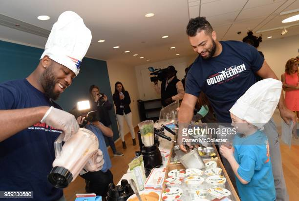 New England Patriots James White and Kyle Van Noy make smoothies with Daniel at Boston Children's Hospital on May 16 2018 in Boston Massachusetts