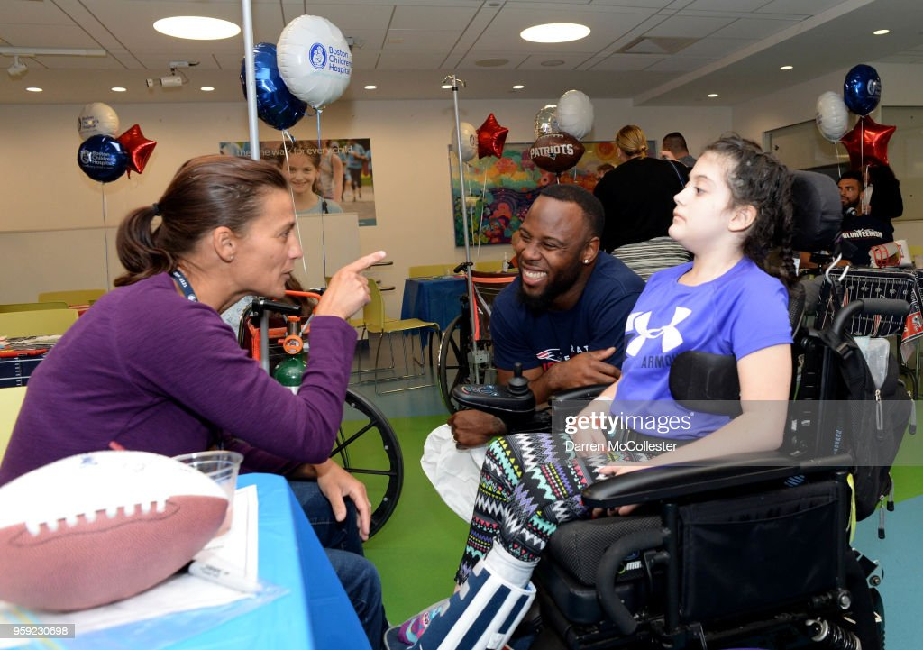 New England Patriots James White visits with Cambry and Mom at Boston Children's Hospital on May 16, 2018 in Boston, Massachusetts.
