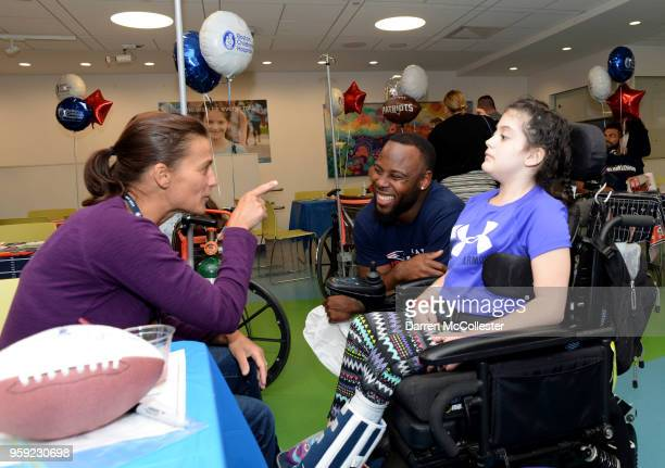 New England Patriots James White visits with Cambry and Mom at Boston Children's Hospital on May 16 2018 in Boston Massachusetts