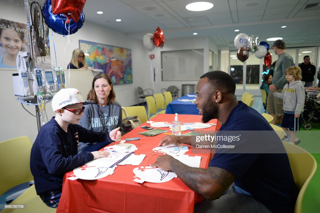 New England Patriots James White visits with Jack at Boston Children's Hospital on May 16, 2018 in Boston, Massachusetts.