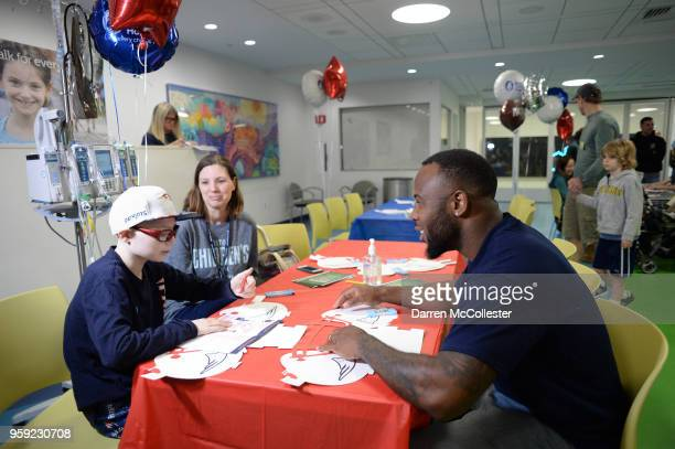New England Patriots James White visits with Jack at Boston Children's Hospital on May 16 2018 in Boston Massachusetts