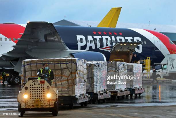 New England Patriots jet arrives at Logan Airport in East Boston on Apr 1 2020 after flying from China with a massive shipment of over one million...