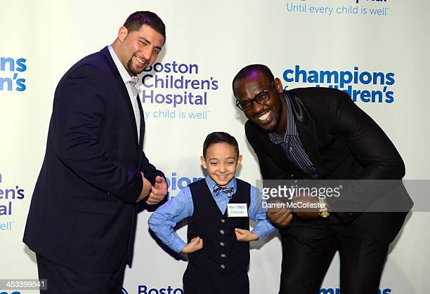 New England Patriots' Joe Vellano and Chandler Jones attend Champions for Children's with Drystan at Seaport World Trade Center on December 3 2013 in...