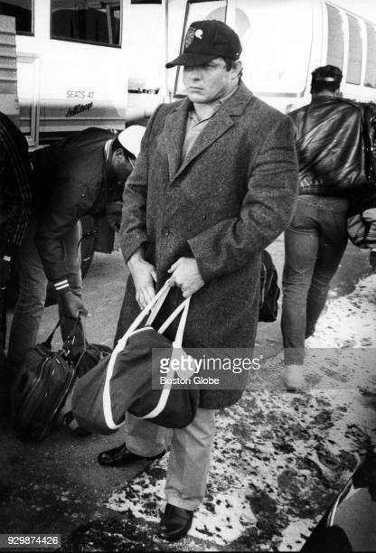 New England Patriots John Hannah arrives from a game in Miami to Sullivan Stadium in Foxborough Mass Dec 17 1985