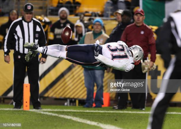 New England Patriots' Jonathan Jones makes a diving play to knock the ball back before it went into the end zone on a second quarter New England punt...