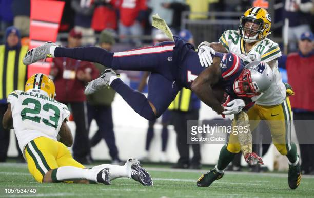 New England Patriots' Josh Gordon is tackled after a reception during the fourth quarter The New England Patriots host the Green Bay Packers in a...
