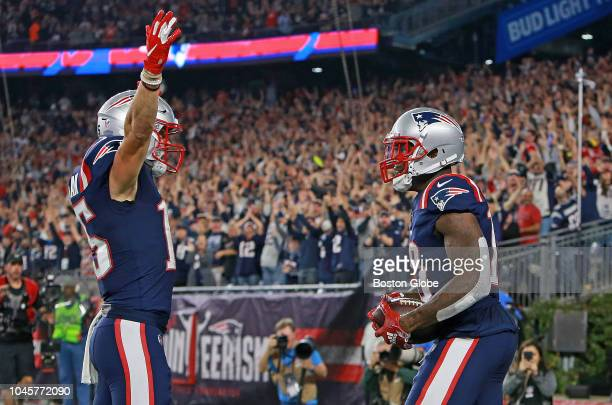 New England Patriots' Josh Gordon right celebrates with teammate Chris Hogan after Gordon caught a 34yard touchdown pass in the fourth quarter The...