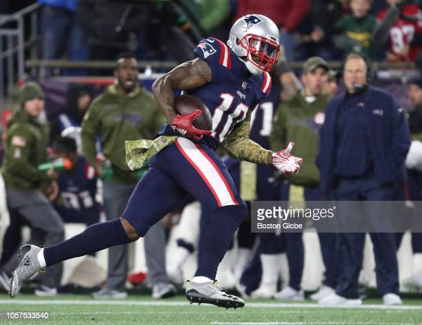 New England Patriots' Josh Gordon runs for a touchdown during the fourth quarter The New England Patriots host the Green Bay Packers in a regular...