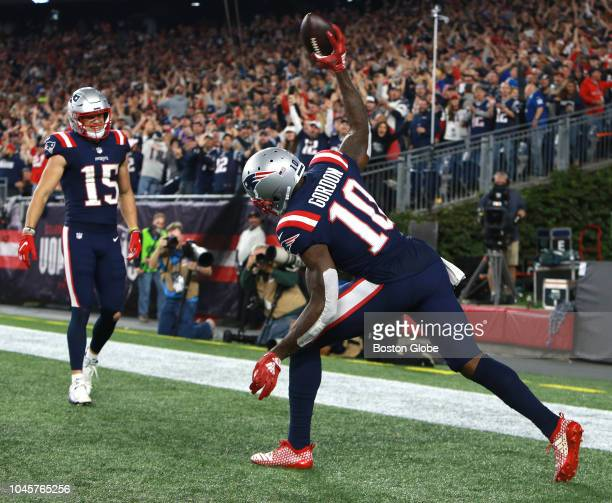 New England Patriots' Josh Gordon spikes the ball after his fourth quarter touchdown while teammate Chris Hogan looks on The New England Patriots...