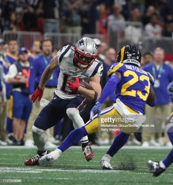 New England Patriots Julian Edelman tries to beat Nickell Robey-Coleman after one of his 7 first half catches near the end of second quarter of Super...