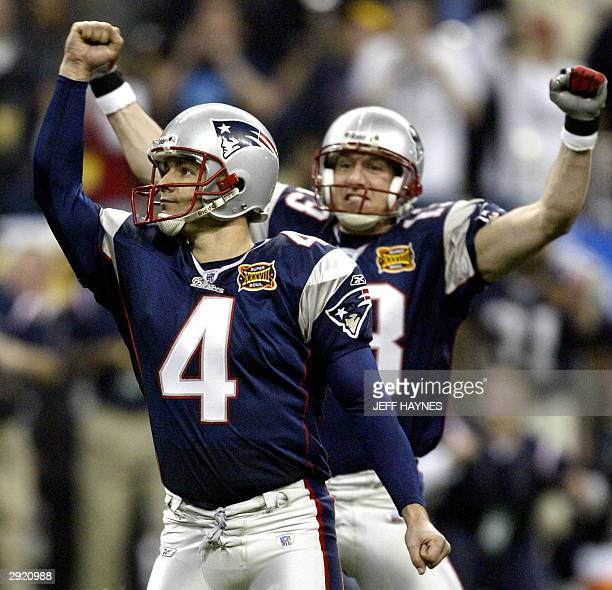 New England Patriots kicker Adam Vinatieri and holder Ken Walter after his game winning 41 yard field goal in the final seconds of the game against...