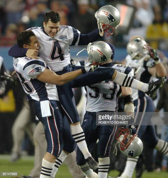 New England Patriots kicker Adam Vinatieri is hoisted in the air after his team's 2421 victory over the Philadelphia Eagles in Super Bowl XXXIX 06...