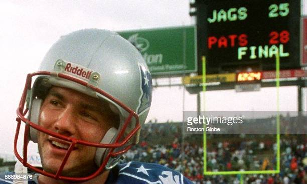 New England Patriots kicker Adam Vinatieri poses for a photo in front of the final score after a game against the Jacksonville Jaguars at Gillette...