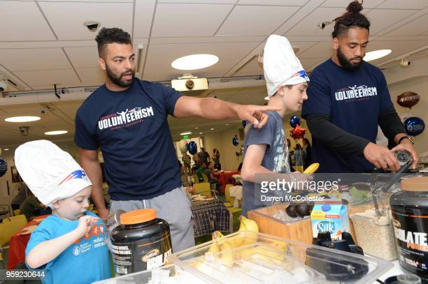 New England Patriots Kyle Van Noy and Harvey Langi make smoothies with Daniel and Evan at Boston Children's Hospital on May 16 2018 in Boston...