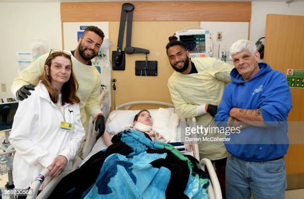 New England Patriots Kyle Van Noy and Harvey Langi visit Dominic and family at Boston Children's Hospital on May 16 2018 in Boston Massachusetts