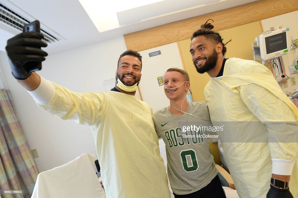 New England Patriots Kyle Van Noy (L) and Harvey Langi visit Steven at Boston Children's Hospital on May 16, 2018 in Boston, Massachusetts.