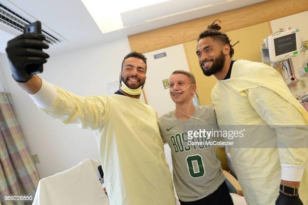 New England Patriots Kyle Van Noy and Harvey Langi visit Steven at Boston Children's Hospital on May 16 2018 in Boston Massachusetts