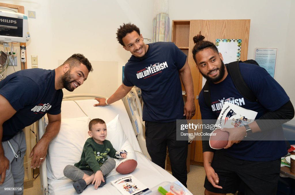 New England Patriots (L to R) Kyle Van Noy, Derek Rivers, and Harvey Langi visit Benjamin at Boston Children's Hospital on May 16, 2018 in Boston, Massachusetts.