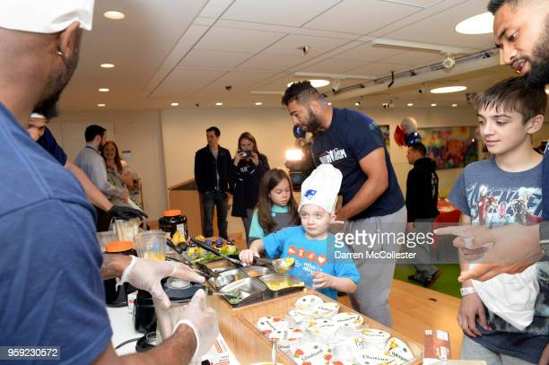 New England Patriots Kyle Van Noy makes smoothies with Parker Daniel and Evan at Boston Children's Hospital on May 16 2018 in Boston Massachusetts